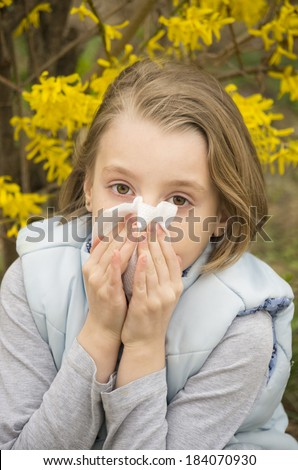 Allergic rhinitis have a little girl. Blowing nose - stock photo