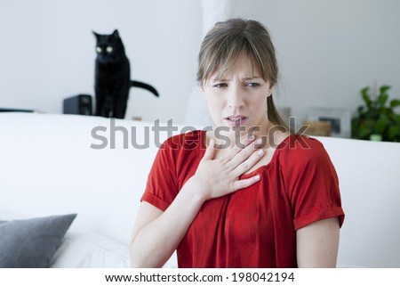 Allergic woman to cats. - stock photo