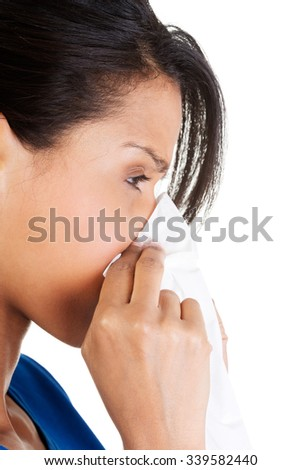 Allergic woman with tissue blowing her nose. - stock photo