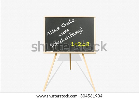 Alles Gute zum Schulanfang (Happy Back to School) written on the blackboard