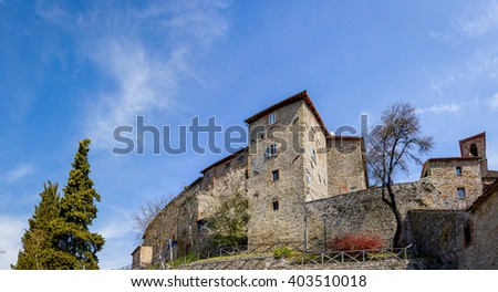 Alley in a Tuscan village with stone houses in sight - stock photo