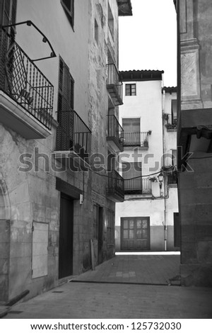 Alley in black and white, Graus, Spain - stock photo