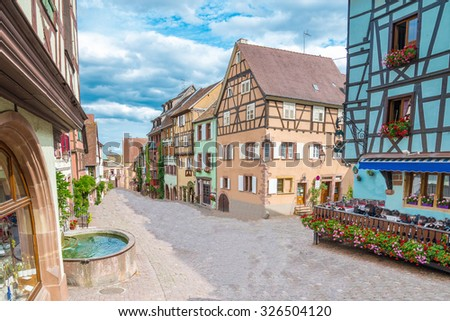 Alley in medieval Riquewihr town on wine route Alsace. Riquewihr known for the Riesling and other great wines produced in the village.