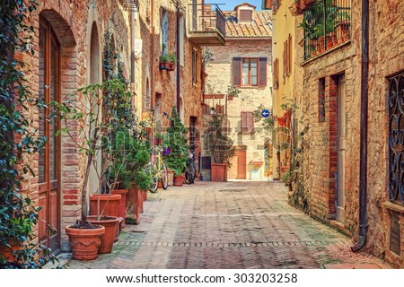 Alley in old town Tuscany Italy - stock photo