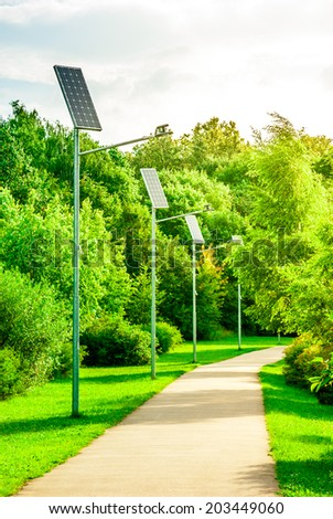 Alley in park with a solar-powered lanterns - stock photo