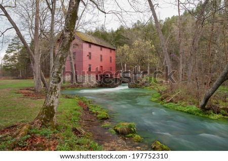 Alley Mill and spring in the Ozarks of Missouri. - stock photo