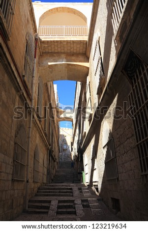 Alley street in the Arab Quarter of the Old City of Jerusalem