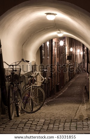 Alley with bicycles in Stockholm - stock photo