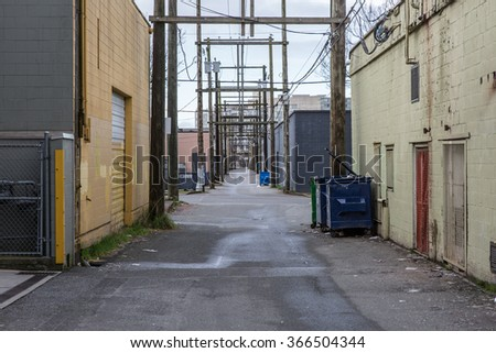 Alley with Overhanging Electrical Wire - stock photo