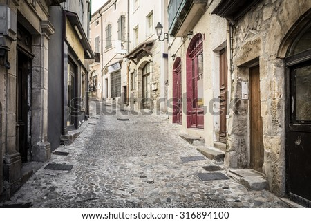 Alleyway in the town of Aubenas, France - stock photo