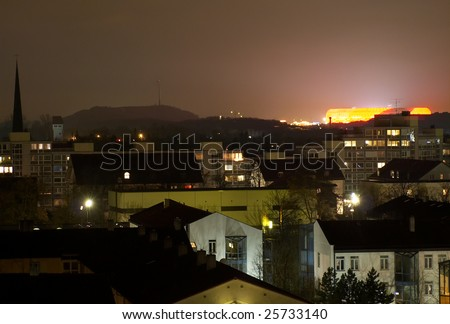 Allianz Arena at night, scene includes cityscape of Garching town - stock photo
