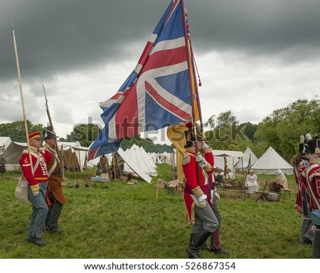 Allied troops parade at the Waterloo 200 re-enactment in Belgium, 20th June 2015, commemorating the Battle of Waterloo in 1815 on the site of the original conflict.