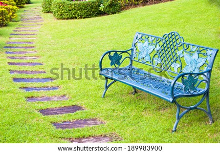 alloy  chair  in the park with  pathway  in the morning - stock photo