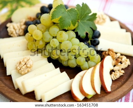 allpe, chees and grape for wine - stock photo