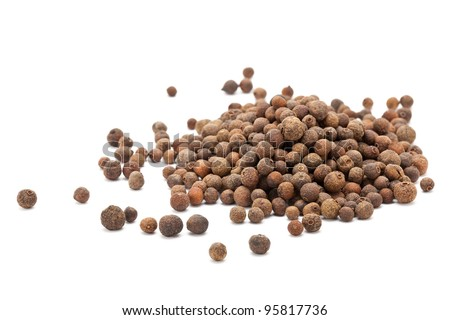 Allspice berries (also called Jamaican pepper or newspice) over white background