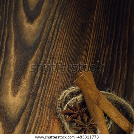 allspice, cinnamon, star anise on the wooden table background