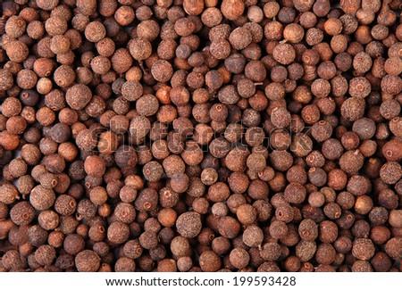 Allspice (jamaican pepper) background - stock photo