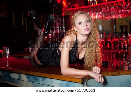 Alluring and fashion girl laying on the table