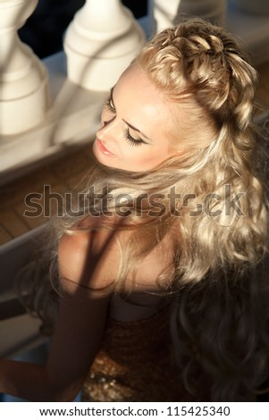 alluring blond relaxing in luxury hotel. Stylish rich slim girl in sexy golden dress with healthy glossy curly hair at villa. Fashion glamorous shot at vacation resort - autumn. Series