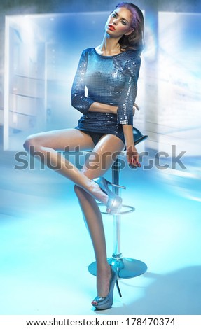 Alluring brunette lady - stock photo