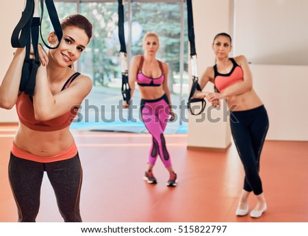 alluring Fitness woman portrait at gym