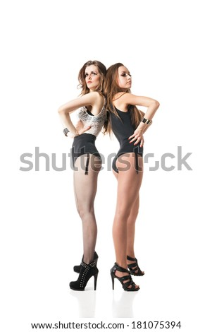 alluring go-go dancers woman posing isolated against white background