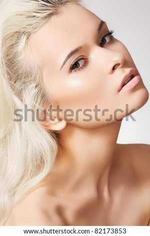 Alluring model face with naturel daily spa make-up and long blond hair. Purity skin, shiny hair - stock photo