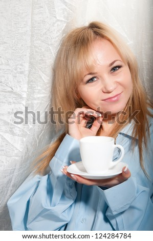 Alluring sexy woman in man boyfriend shirt at home with coffee at morning