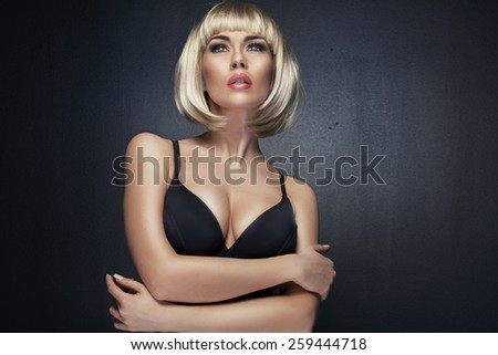 Alluring woman wearing blacklingerie - stock photo