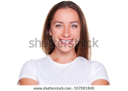 alluring young woman looking and smiling. studio shot over white background