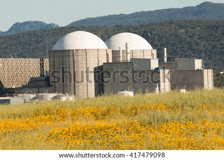 Almaraz nuclear power plant in the center of Spain, surrounded by a flowery field
