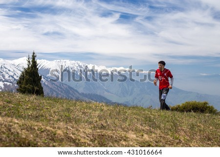 ALMATY, ALMATY DISTRICT,KAZAKHSTAN - MAY 22, 2016: Open competition SKY RUNNING 2016 held in Eliksay gorge. Man runs up to the mountain participating in the competition