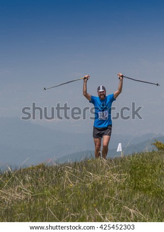 ALMATY, ALMATY DISTRIKT,KAZAKHSTAN - MAY 22, 2016: Open competition SKY RANNING 2016 held in Eliksay gorge. A man runs up to the mountain named Bukreeva participating in the competition.