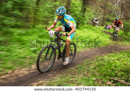 "ALMATY, KAZAKHSTAN - APRIL 10, 2016: D.Aybakunov (33*) in action at cross-country competition ""Open season - Bikes relay 2016""  - stock photo"