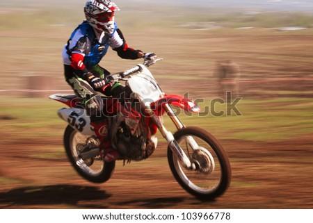 "ALMATY, KAZAKHSTAN - APRIL 22 D.Barnukovsky (N53) at the Motocross competition ""Fabrichny Cup""- Open Championship of Kazakhstan on April 22, 2012 in Almaty, Kazakhstan. - stock photo"