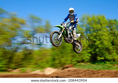 ALMATY, KAZAKHSTAN - APRIL 21 E.Efanov(N122)  at the Motocross competition - 3rd stage of Open Championship of Kazakhstan on April 21, 2013 in Almaty, Kazakhstan. - stock photo