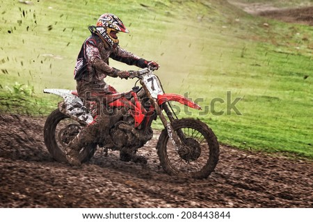 """ALMATY, KAZAKHSTAN - APRIL 14 I.Belobrodov (N77) and other at the Motocross competition """"Fabrichny Cup""""- Open Championship of Kazakhstan on April 14, 2013 in Almaty, Kazakhstan. - stock photo"""