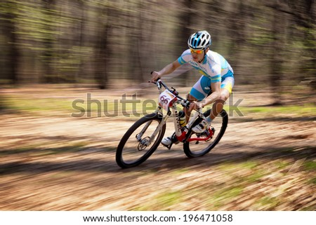 "ALMATY, KAZAKHSTAN - APRIL 19, 2014: K.Kazatncev (N66) in action at cross-country competition ""Open season - Bikes relay 2014""  - stock photo"