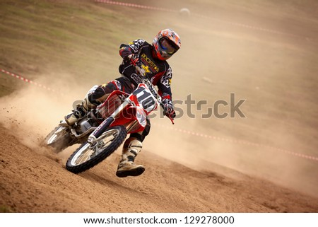 """ALMATY, KAZAKHSTAN - APRIL 10: R.Shevelev(110) at the Motocross competition """"Fabrichny Cup""""- Open Championship of Kazakhstan on April 10, 2011 in Kargaly, Kazakhstan. - stock photo"""