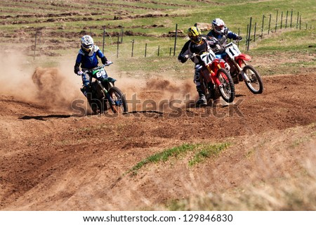 """ALMATY, KAZAKHSTAN - APRIL 22 V.Shevelev (N70) and other at the Motocross competition """"Fabrichny Cup""""- Open Championship of Kazakhstan on April 22, 2012 in Almaty, Kazakhstan. - stock photo"""