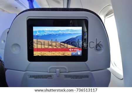 ALMATY, KAZAKHSTAN -25 AUG 2017- Inside the Business Class cabin of an airplane from Kazakhstan flag carrier Air Astana (KC). Its frequent flyer program is called the Nomad Club.