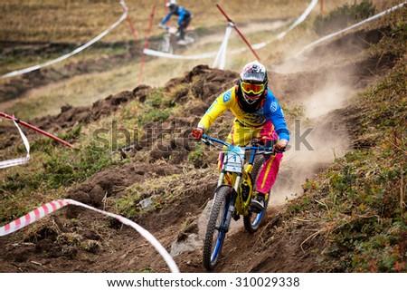 ALMATY, KAZAKHSTAN - AUGUST 22, 2015: J.Kumakbayev (N1) in action at Mountain Bike sports event DOWNHILL EXTREME WEEKEND.  - stock photo