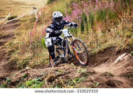 ALMATY, KAZAKHSTAN - AUGUST 22, 2015: Y.Shilin (N8) in action at Mountain Bike sports event DOWNHILL EXTREME WEEKEND. 