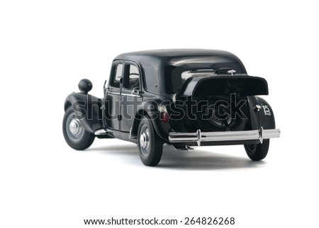 ALMATY, KAZAKHSTAN - FEBRUARY 23, 2014: Black vintage retro car with an open trunk isolated on white background - stock photo