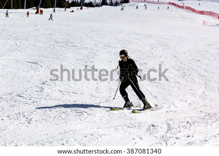 Almaty, Kazakhstan -February 28, 2016. skier descends from the mountain on the ski run - stock photo