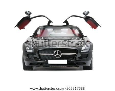 ALMATY, KAZAKHSTAN - june 22, 2014 - Collectible toy car Mercedes-Benz SLS Sedan with open doors isolated on white background