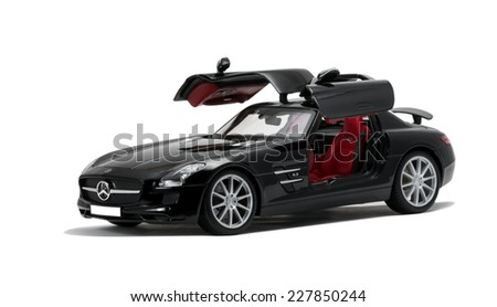 ALMATY, KAZAKHSTAN - june 22, 2014 - Collectible toy Mercedes-Benz SLS Sedan open the door isolated on white background - stock photo