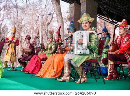 ALMATY, KAZAKHSTAN - MARCH 22, 2015: Musicians in Kazakh traditional costumes with national instruments on the stage at Nauryz celebration - stock photo