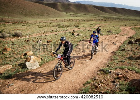 "ALMATY, KAZAKHSTAN - MAY 01, 2016: A.Pavlov (N3) in action at Adventure mountain bike cross-country competition in mountains ""Jeyran Trophy 2016""  - stock photo"