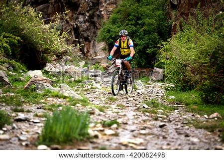 "ALMATY, KAZAKHSTAN - MAY 01, 2016: E.Asafov (N18) in action at Adventure mountain bike cross-country competition in mountains ""Jeyran Trophy 2016""  - stock photo"